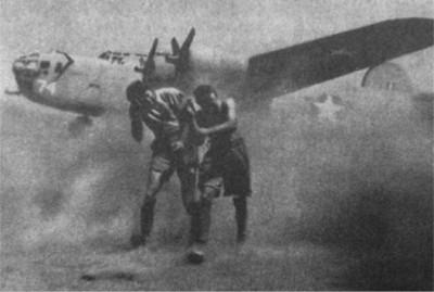 Airmen fighting sandstorm in desert of North Africa